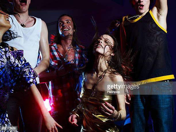 group of friends dancing - nightclub stock pictures, royalty-free photos & images