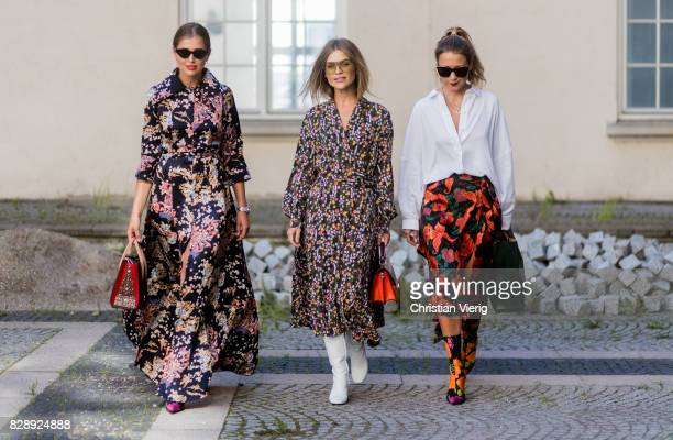 Group of friends Darja Barannik wearing a dress with floral print Balenciaga boots outside Holzweiler on August 09 2017 in Copenhagen Denmark