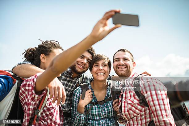 group of friends doing a selfie on the mountain