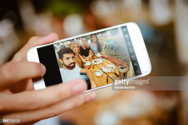 group of friends doing breakfast all together and taking a selfie