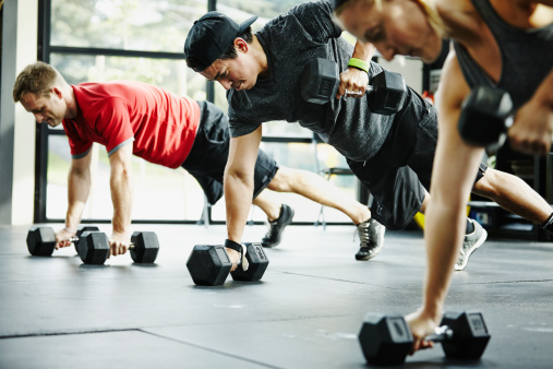 Group of friends doing pushups with dumbbells - gettyimageskorea
