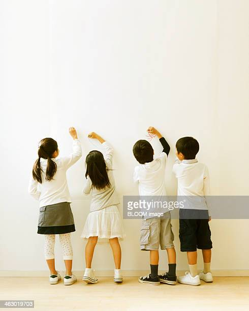 Group Of Friends Drawing On Wall