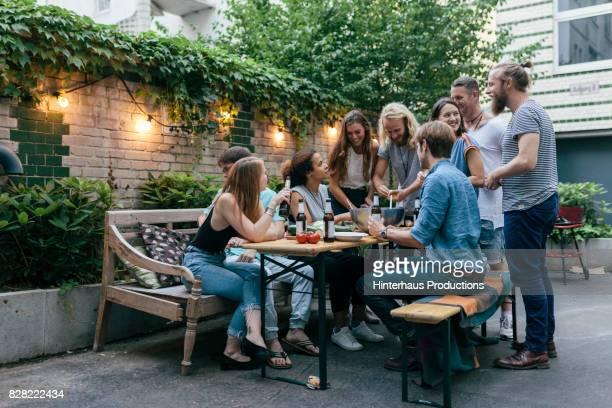group of friends drinking and preparing food for barbecue together - tischflächen aufnahme stock-fotos und bilder
