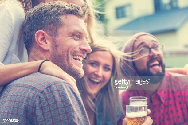 Group of friends drinking beer and having fun.