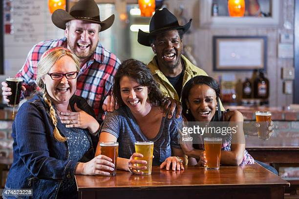 Group of friends drinking beer in a restaurant bar