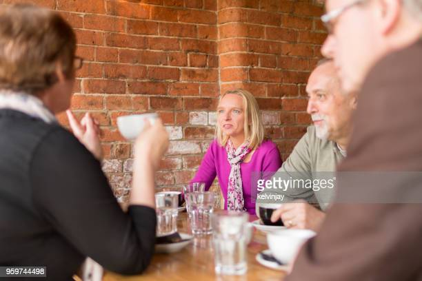 A group of friends drinking coffee in a bar