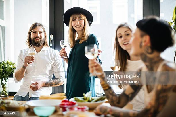Group of friends drinking glass of wine