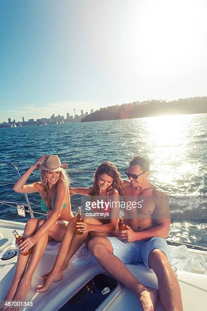Group of friends drinking on a boat