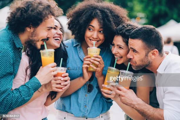 Group of friends drinking smoothies
