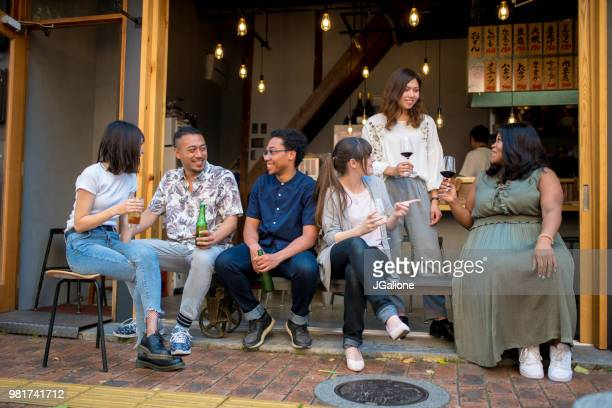 Group of friends drinking together at a Japanese Izakaya