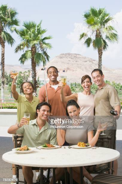 group of friends eating and drinking at golf clubhouse - country club stock pictures, royalty-free photos & images