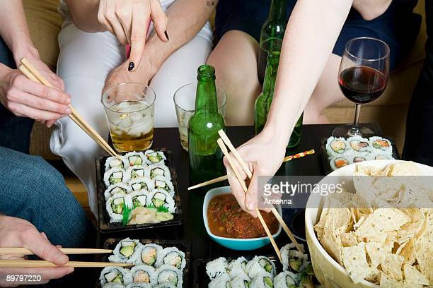 A group of friends eating and drinking together