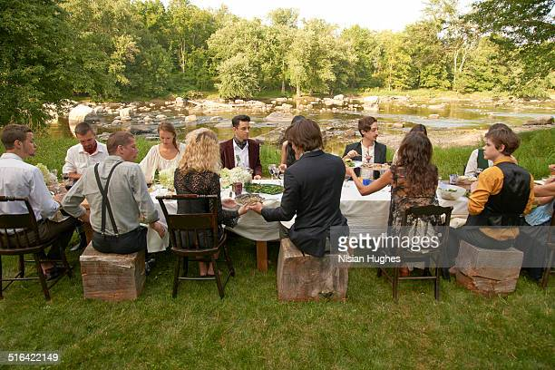 Group of friends eating at an outdoor dinner party