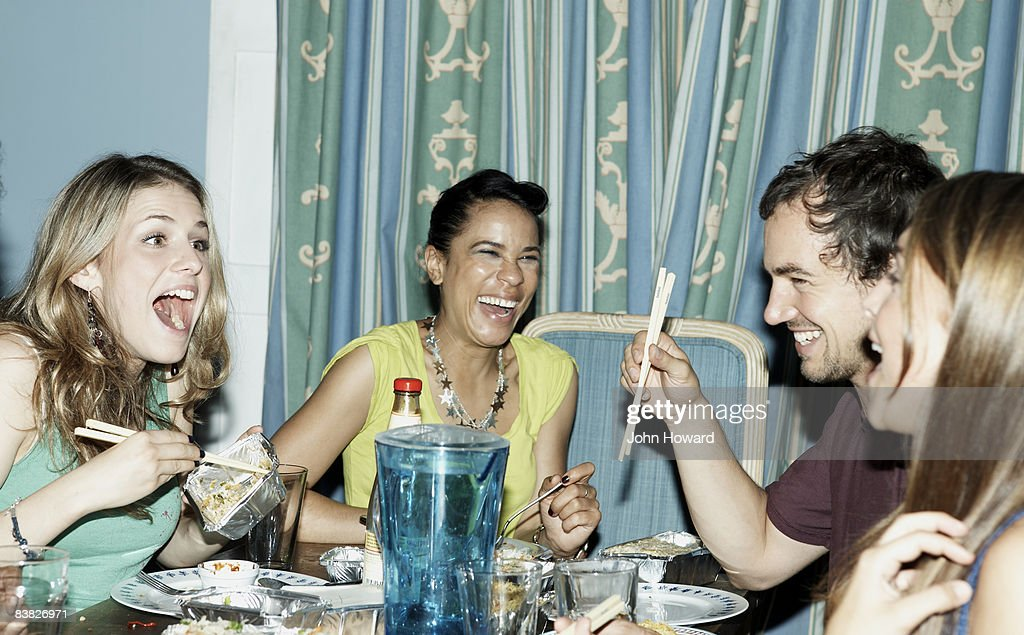 Group of friends eating fast food with chopsticks : Stock Photo