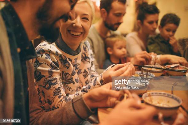 group of friends eating in a chinese restaurant - two generation family stock pictures, royalty-free photos & images