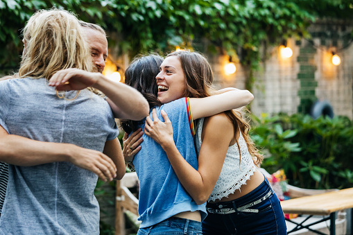A Group Of Friends Embrace, Excited To See Each Other At Barbecue Meetup - gettyimageskorea