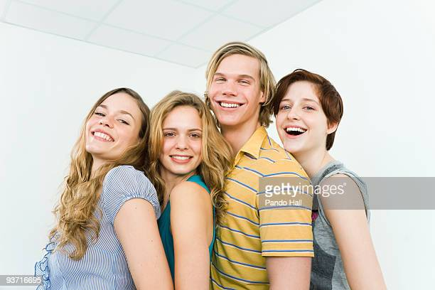 Group of friends embraced, laughing