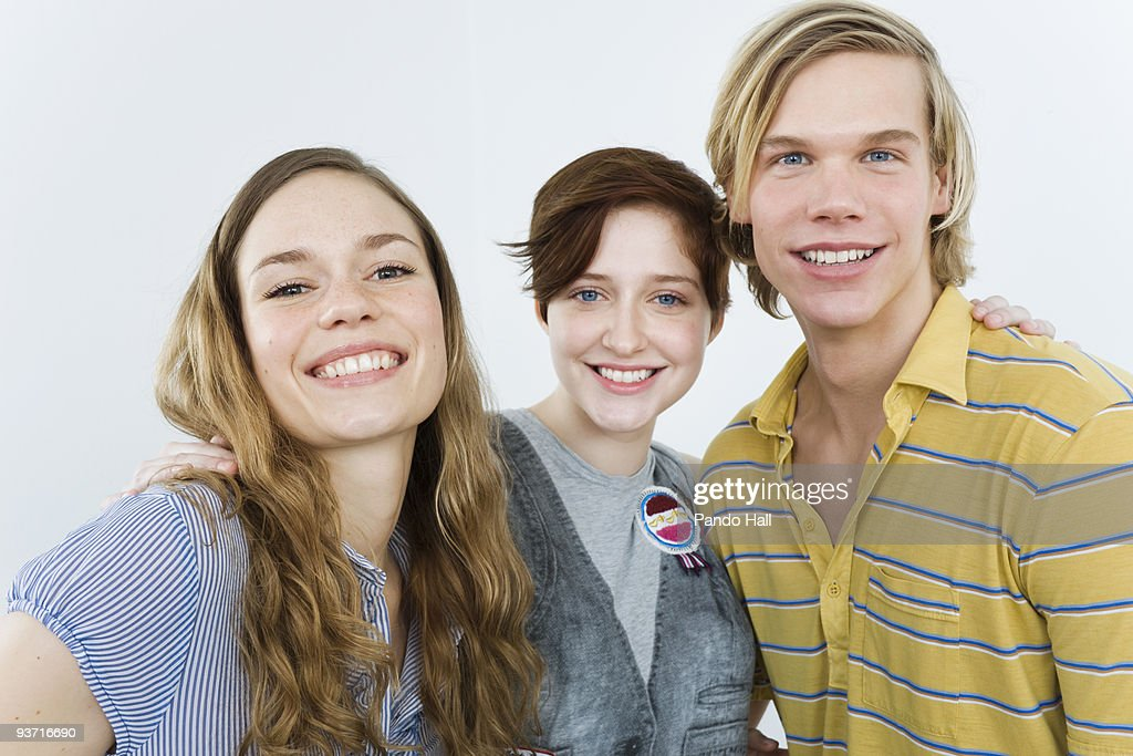 Group of friends embraced, smiling : Stock Photo