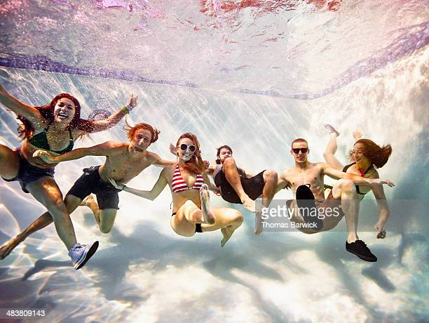 Group of friends embracing underwater
