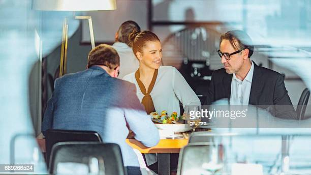 Group of friends enjoy chatting during lunch time at Asian restaurant