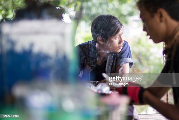 A 'WARKOP' AT MADURA ISLAND MADURA INDONESIA A group of friends enjoy coffee and wifi in a Warkop in Madura Island 'Warkop' is the name of Indonesia...