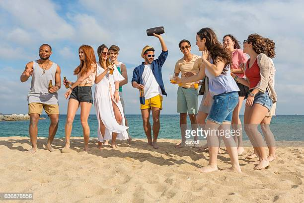 Group of Friends Enjoying a Fun Beach Party