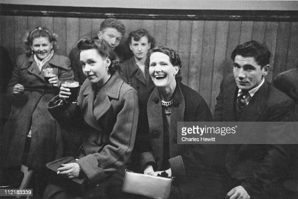 A group of friends enjoying a glass of beer in a pub Dublin July 1955 Original Publication Picture Post 7890 Dublin's Saturday unpub