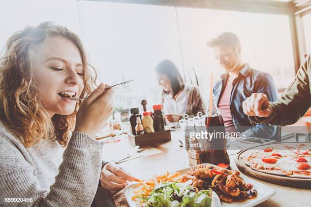Group of friends enjoying a meal in a restaurant.