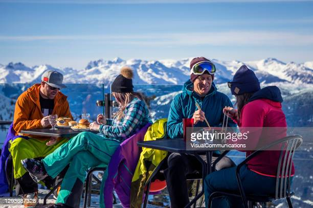 group of friends enjoying apres-ski at top of whistler mountain. - canada stock pictures, royalty-free photos & images