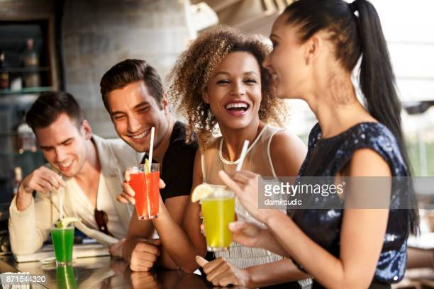 group of friends enjoying cocktails - cocktail party stock pictures, royalty-free photos & images