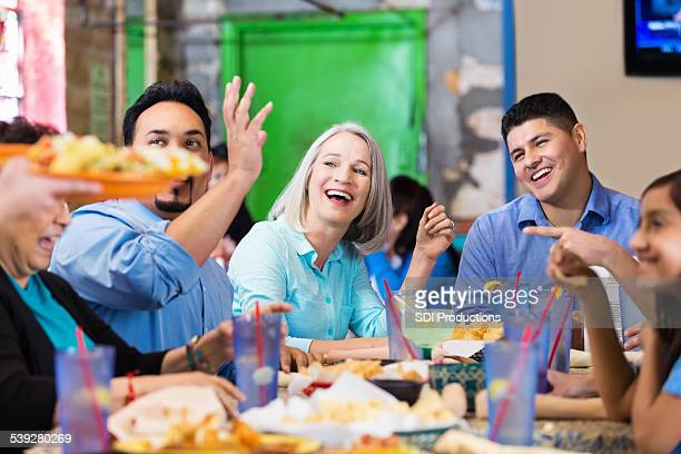 Group of friends enjoying dinner together in casual restaurant