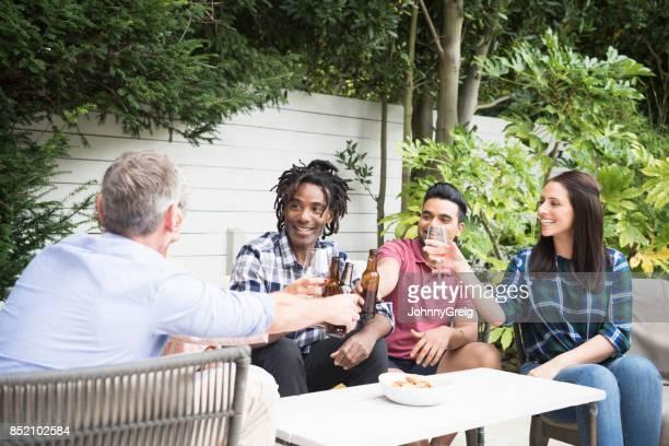 Group of friends enjoying drinks in garden