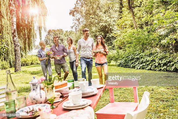 group of friends enjoying garden party - gartenparty stock-fotos und bilder