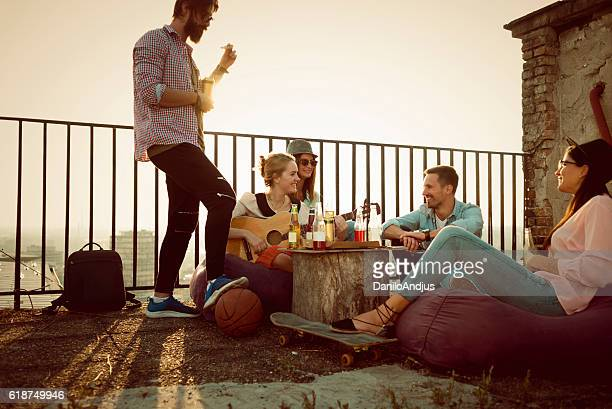 group of friends enjoying on the roof