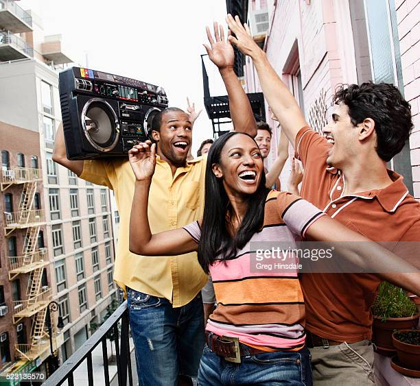 Group of friends enjoying party on balcony