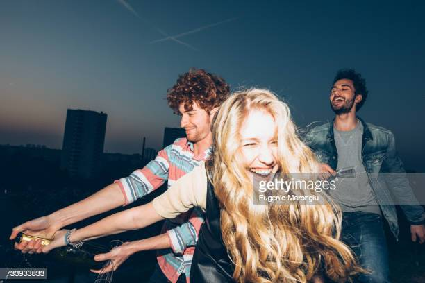 group of friends enjoying roof party - tetto foto e immagini stock