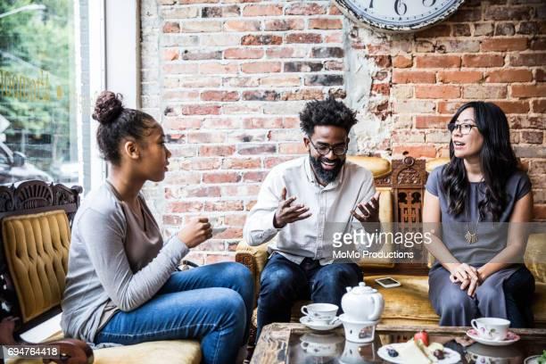 Group of friends enjoying tea at cool teashop