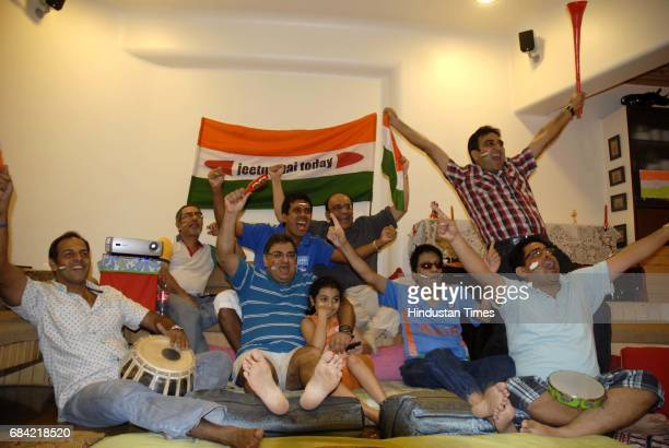 Group of friends enjoying the Cricket World Cup 2011 Final match between India and Sri Lanka at one of the flats in Venus Apartments Worli