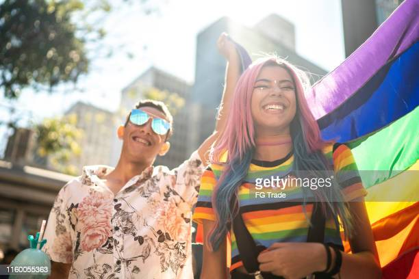 group of friends enjoying the lgbtqi parade - pride stock pictures, royalty-free photos & images