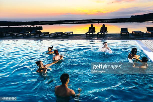 group of friends enjoying the pool party - pool party stock pictures, royalty-free photos & images