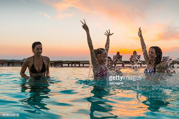 group of friends enjoying the pool party - poolside stock pictures, royalty-free photos & images