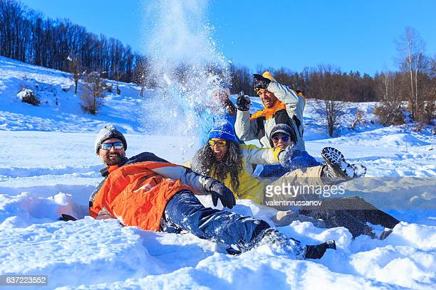 Group of friends enjoying the snow