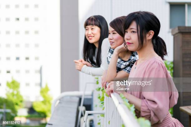 Group of friends enjoying the view from a rooftop