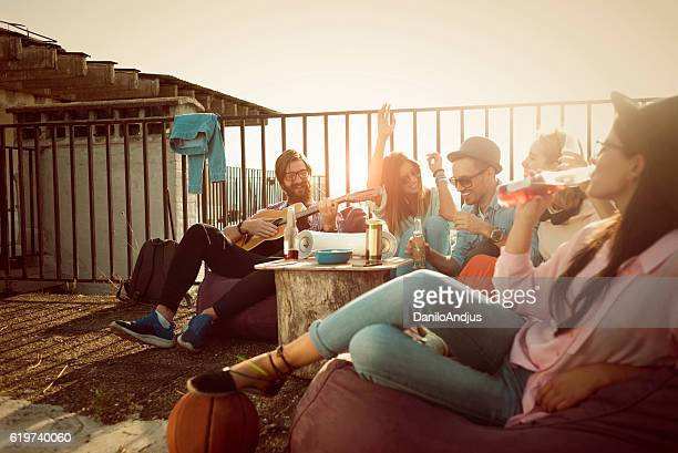 group of friends enjoying their own party on the roof