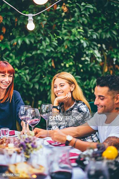 Group of friends enjoying together at a dinner party