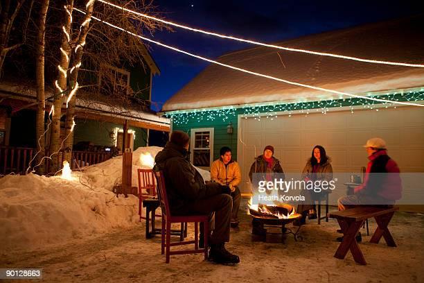 Group of friends enjoying winter bonfire.