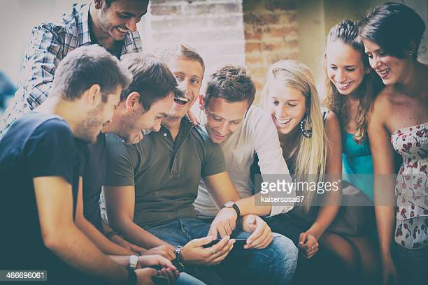 Group of friends enjoying with a digital tablet
