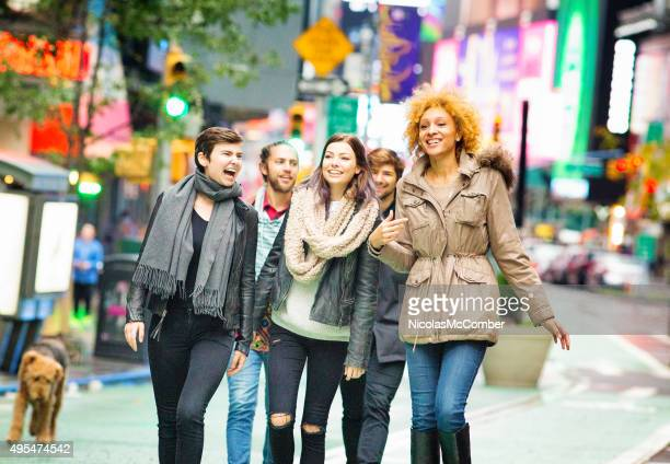 Group of friends excited at visiting Times Square Manhattan