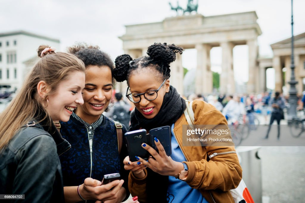 A Group Of Friends Exploring Berlin : Stock Photo