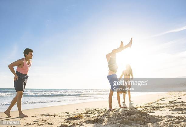 Group of friends fooling around on beach